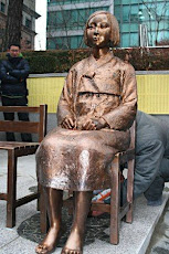"A small ""Korean"" girl statue <br>sitting quietly in front of ""Japanese"" embassy in Seoul"