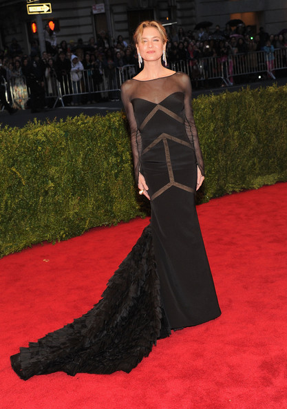 Renée Zellweger in a custom Peter Dundas for Emilio Pucci mermaid-style, black silk gown with a deep open back, sheer chiffon details and a generously long organza ruffled train at the Costume Institute Benefit Gala 2012 held at The Metropolitan Museum of Art on May 7, 2012 in New York City.