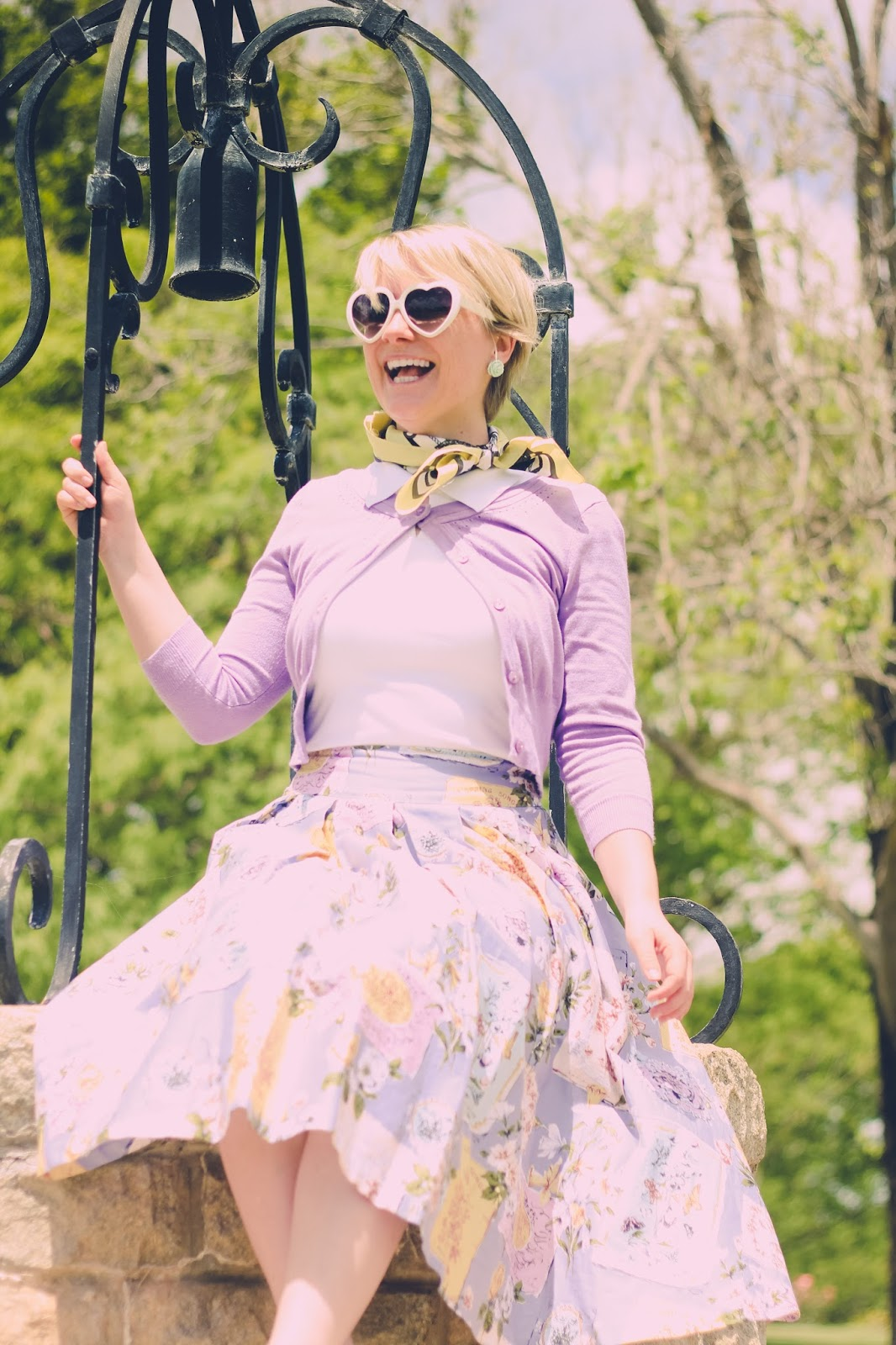 Liana of Finding Femme wears Review Australia tennis top, purple cardigan and love letter midi skirt with yellow neck tie, mint Modcloth earrings and mint sandals by BAIT footwear.