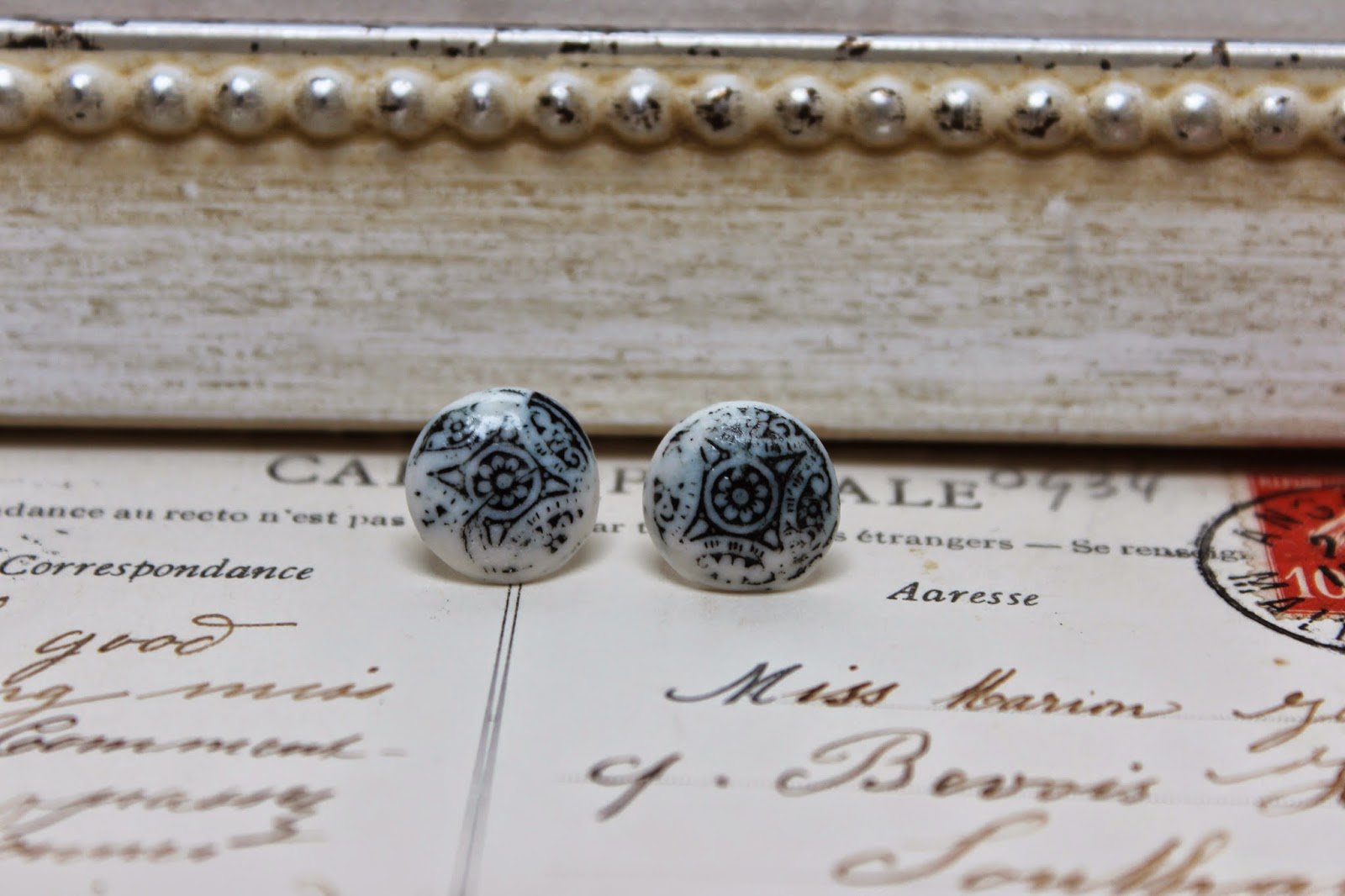 http://www.amanda-mercer.co.uk/pretty-things-for-you/patterned-button-stud-earrings