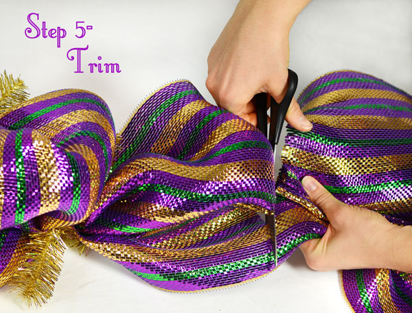 At the end of the tinsel tie garland form, trim the deco mesh.