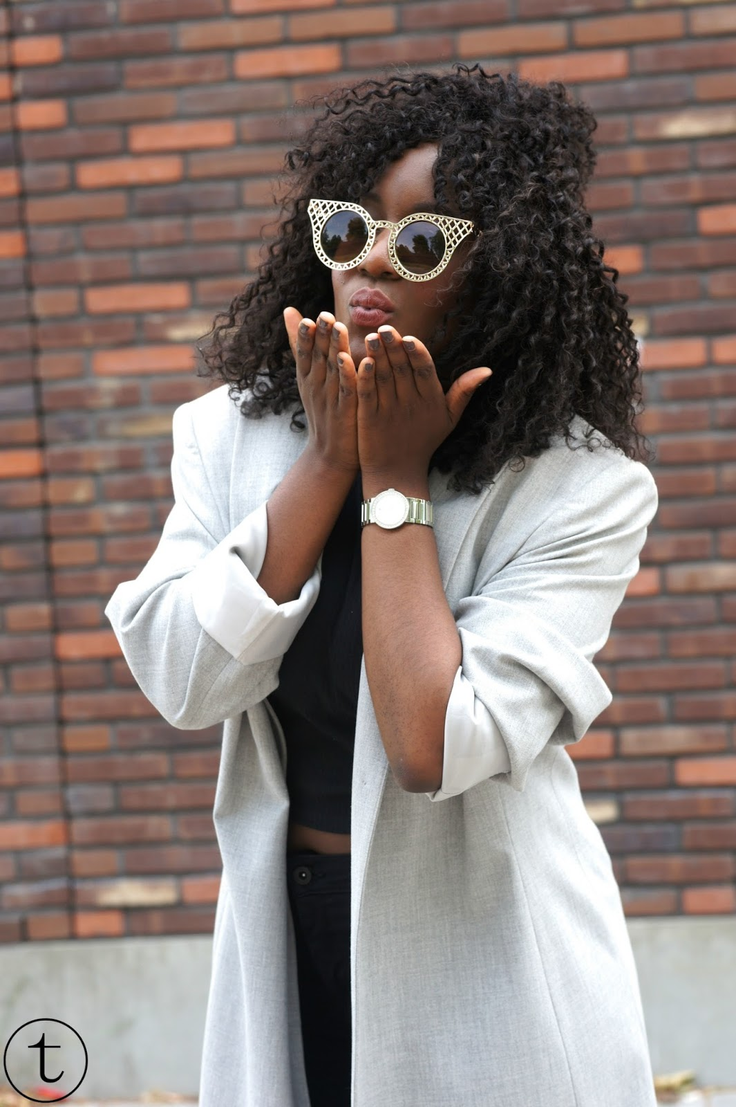 outfit post wearing a long grey coat and golden sunglasses from polette