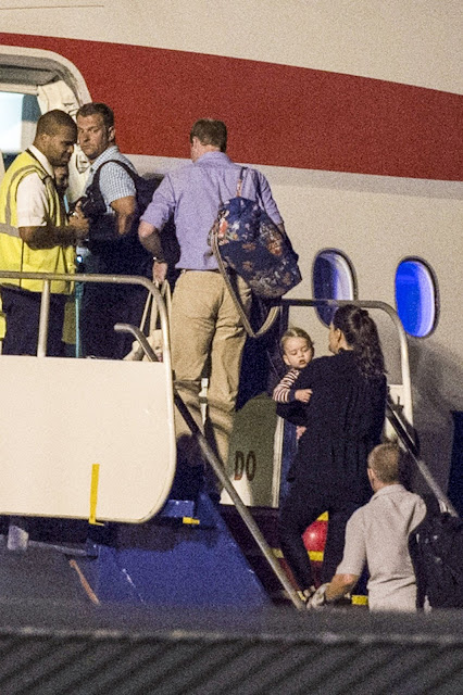 The Duke and Duchess of Cambridge, Prince George fly back to the UK