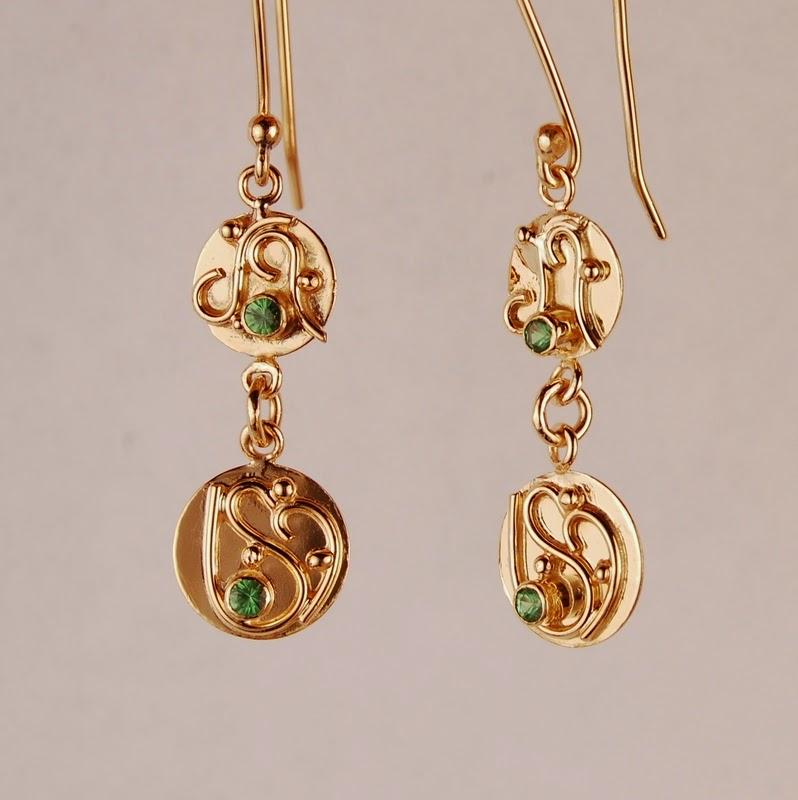 Two circles dangling with green stones