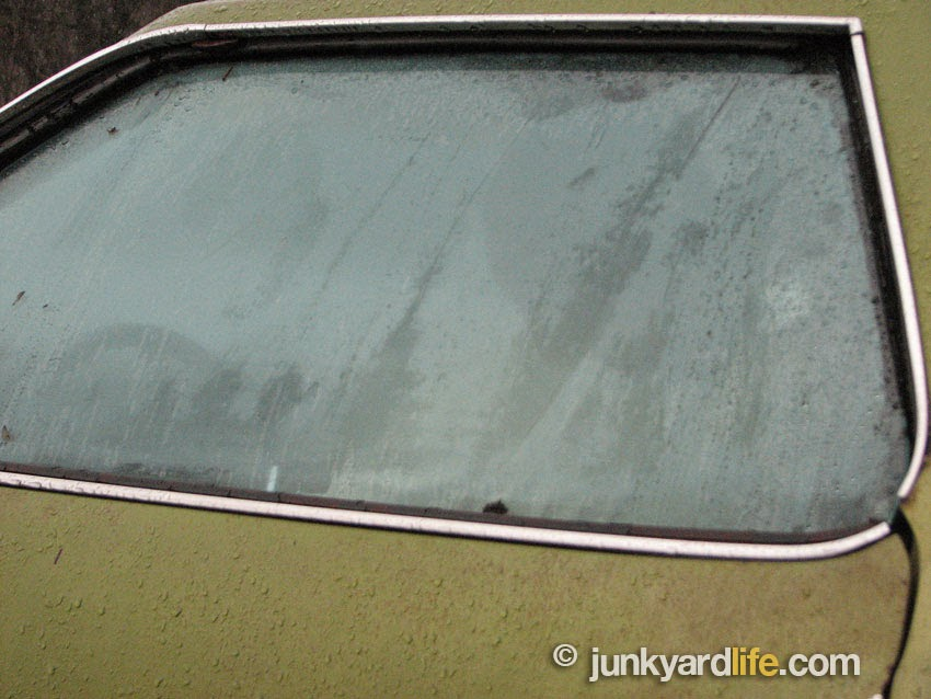 Visibility was limited during the rainy drive in the 1973 Pontiac.