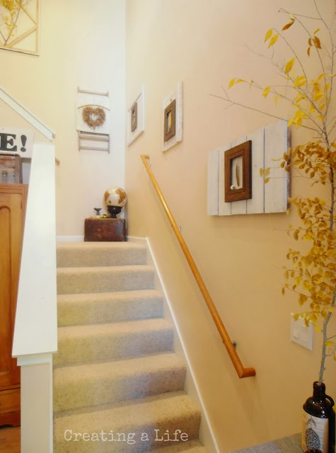 http://creatingalifenow.blogspot.com/2013/10/nature-inspired-fall-foyer-pt-2-stairway.html