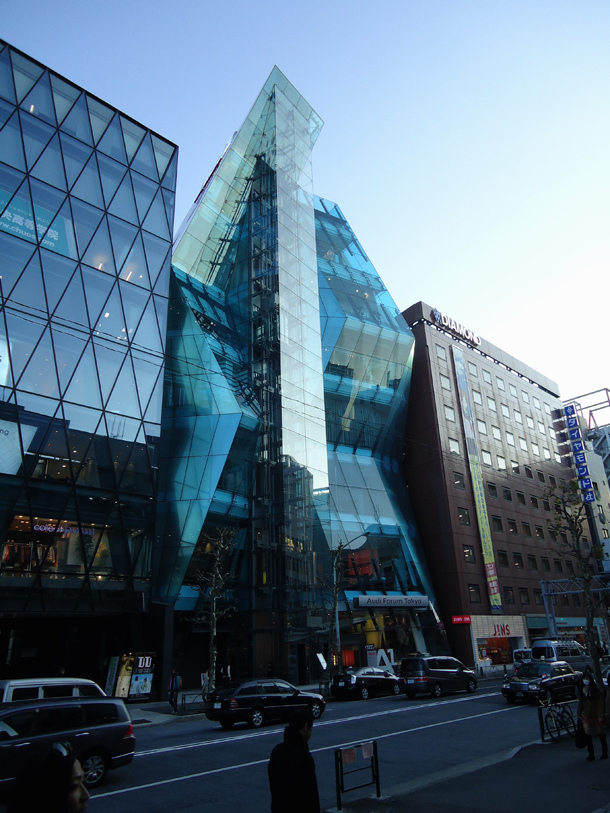 Glassy modern building seen from the street