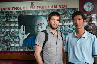 Photo of Collin Sullivan, member of Benetech's Human Rights Field Team, standing next to a staff member of the Assistance Association for Political Prisoners (Burma).