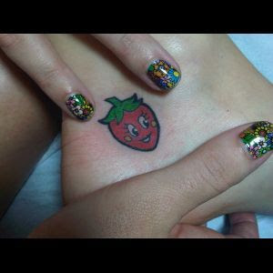 Katy Perry's (Grinning) Strawberry Tattoo