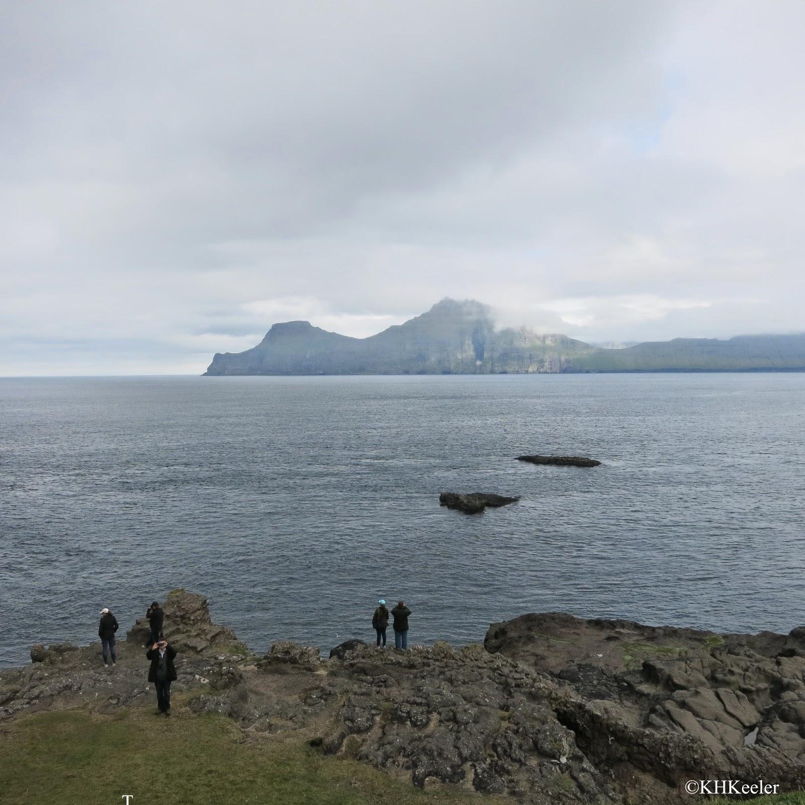 Faroe Island coastline, with bird watchers