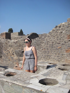 Erin working behind the counter of one of Pompeii's many fine food establishments.