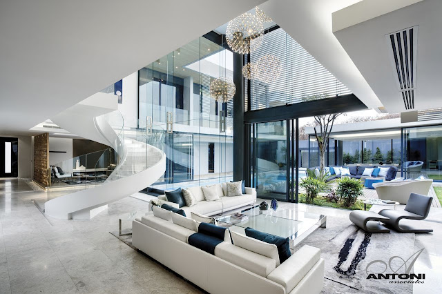 Picture of white living room furniture with the exit to the backyard and the terrace