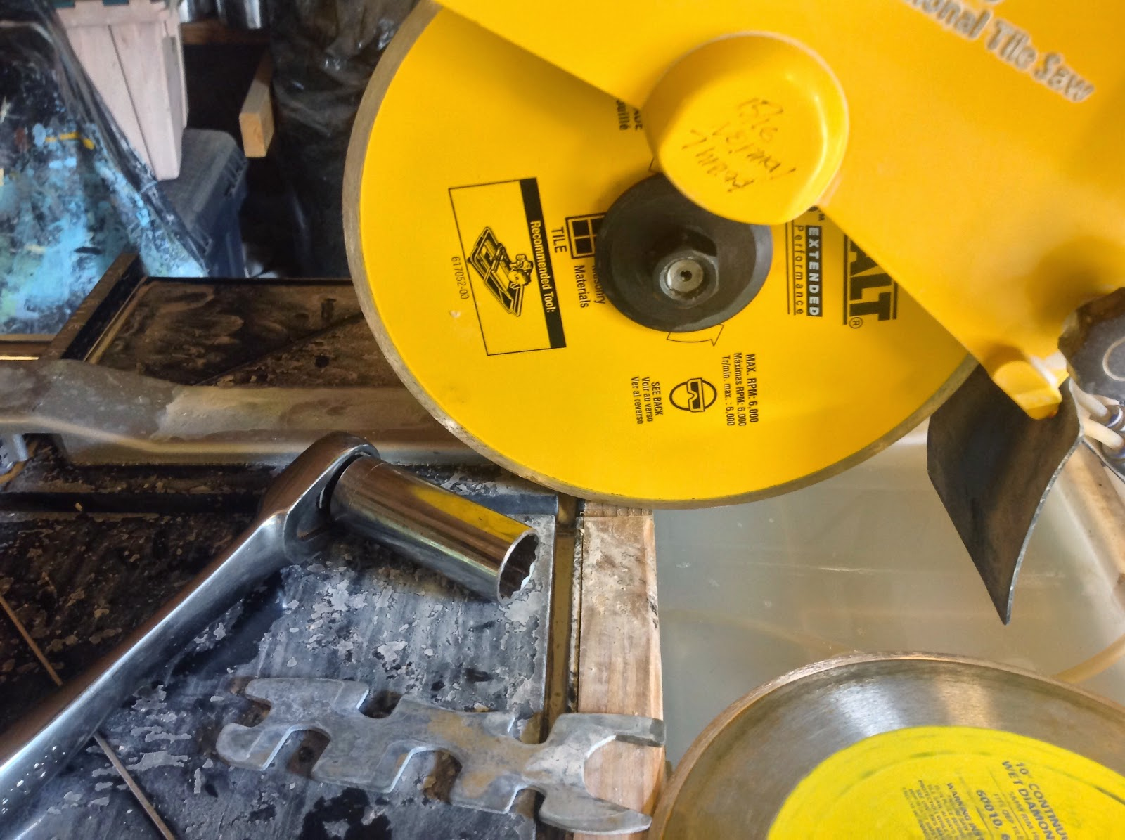 How to use a tile wet saw tips for those wet behind the ears tile saw blade change greentooth Image collections