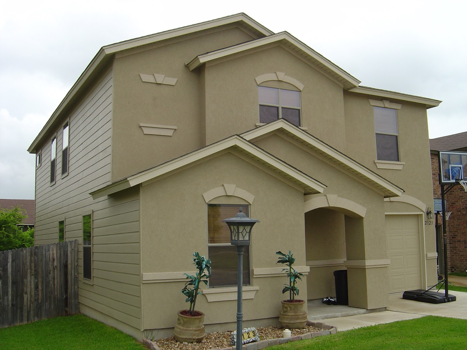 From dirt to dream home sort of the process of for Stucco facade