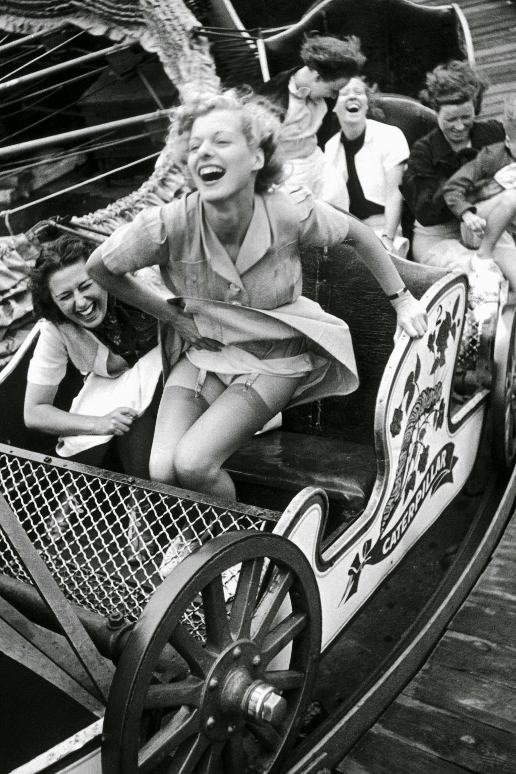 Two young women enjoying themselves on a rollercoaster at ...