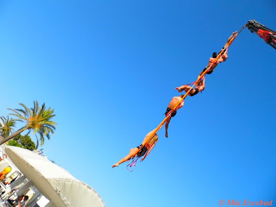 Acrobats in mid air at Ocean Beach Ibiza