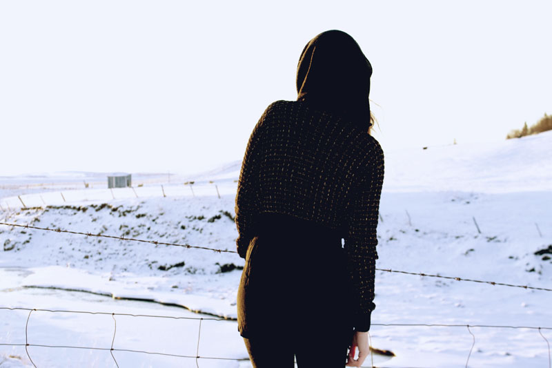black snood, river island cropped black and gold jumper, black miss selfridge playsuit. iceland fashion