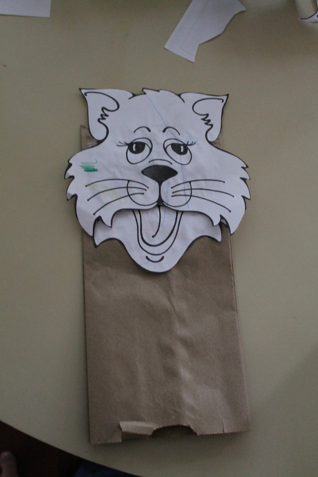 The Bug made a paper bag puppet of a puppy dog. (The book I got the ...
