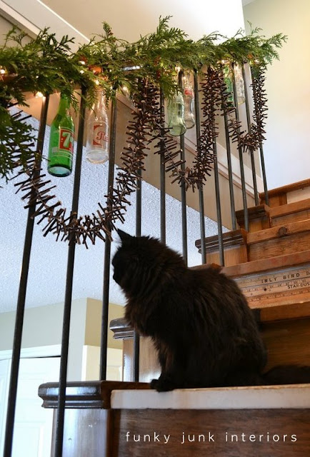 A Christmas garland made from twigs via http://www.funkyjunkinteriors.net/