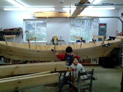 goofy children in the Fairview, NC boat builders' workshop