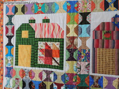 closeup of quilting on spools in quilty barn quilt