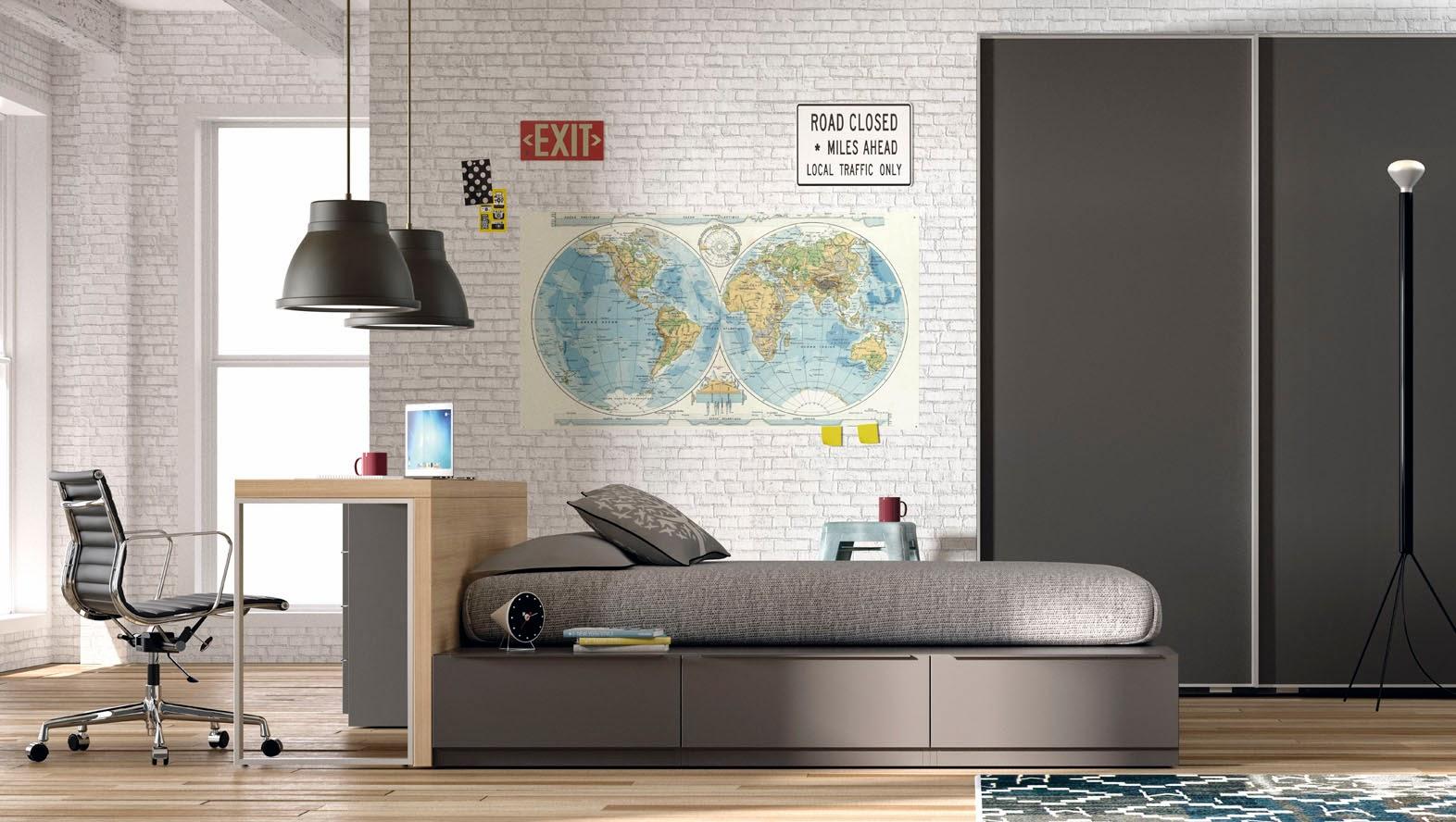 dormitorio con cama con cajones y mesa de estudio