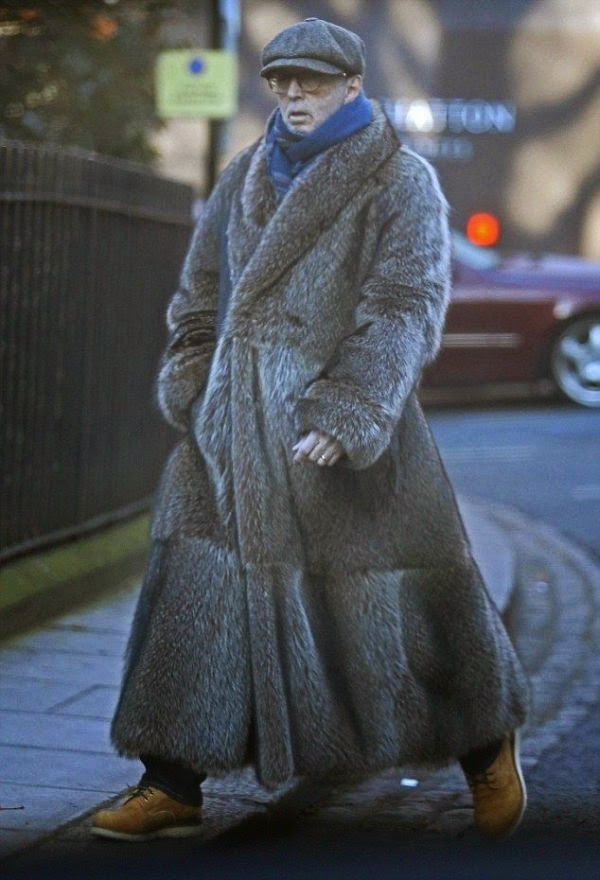 It seemed like Eric Clapton may not just be done to following around as he stepped out by herself on the street at London, England on Monday, December 29, 2014.