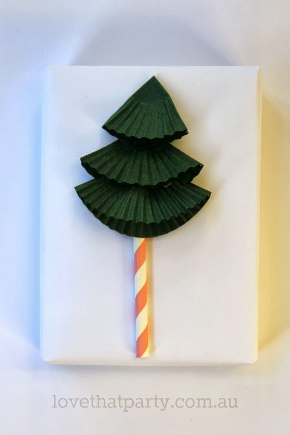 Cute and Easy Christmas Tree Gift Wrap using cupcake pans and paper straws! www.lovethatparty.com.au
