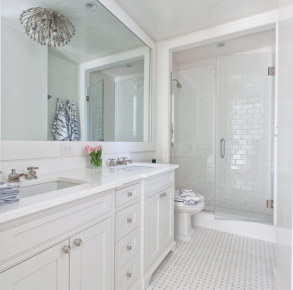 Open design tall clear glass shower doors emphasize the for Small bathroom high ceiling