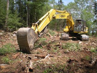 Backhoe digging, Ely MN, http://huismanconcepts.com/