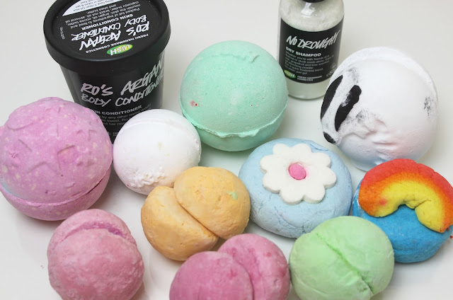 A picture of Lush products including Lush Bath Bombs, Lush Bubble Bars, Lush Dry Shampoo and Lush Body Conditioners