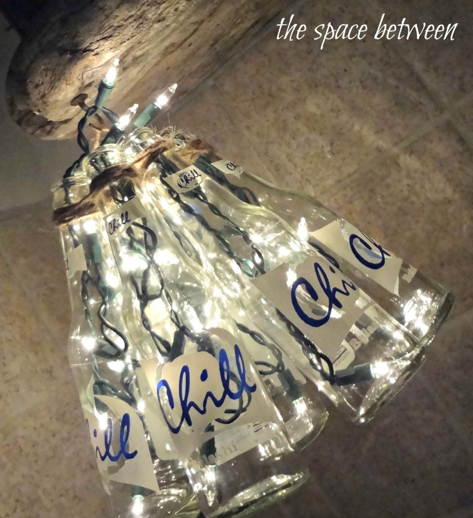 http://thespacebetweenblog.net/2012/06/28/diy-bottle-craft-chandelier/