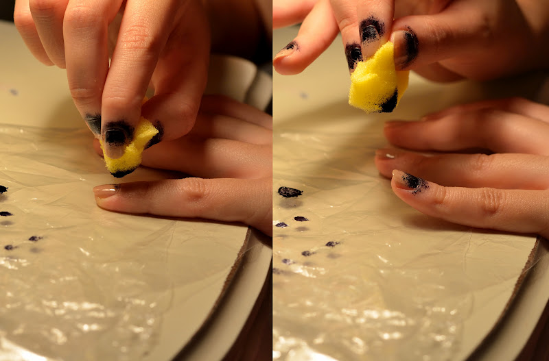 use a sponde to dab the black nailpolish at the root of the nail