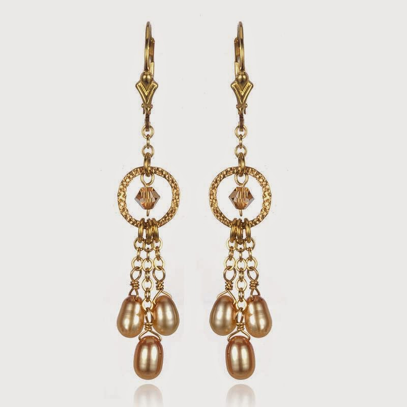 http://artisandesigngallery.com/jewelry/earrings/1083/creme-pearls-and-champagne-swarovski-austrian-crystal-earrings/