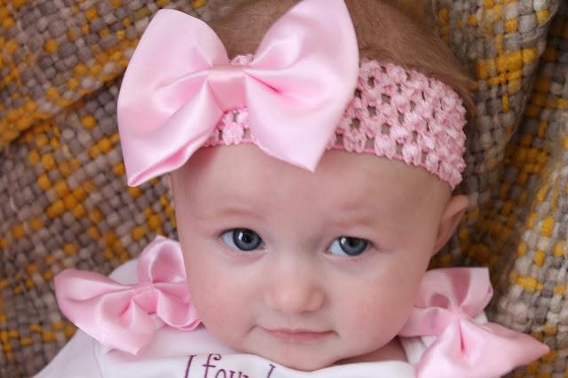 cute baby wearing big pink bow headband