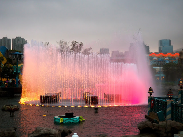 Fountain with coloured lights in the evening, in Aqua City Lagoon, Ocean Park, Hong Kong