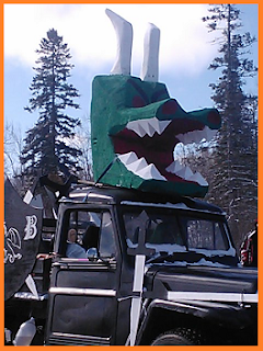 Dragon head with open mouth atop a black truck