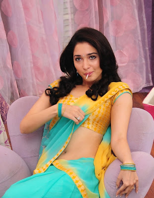 Tamanna Hot Navel Cleavage Show with Lollypop Pictures