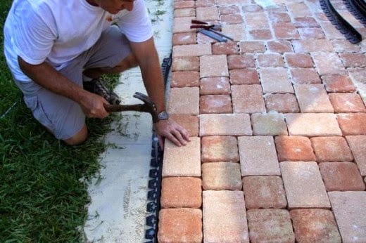 securing the edging for the patio stone pavers project
