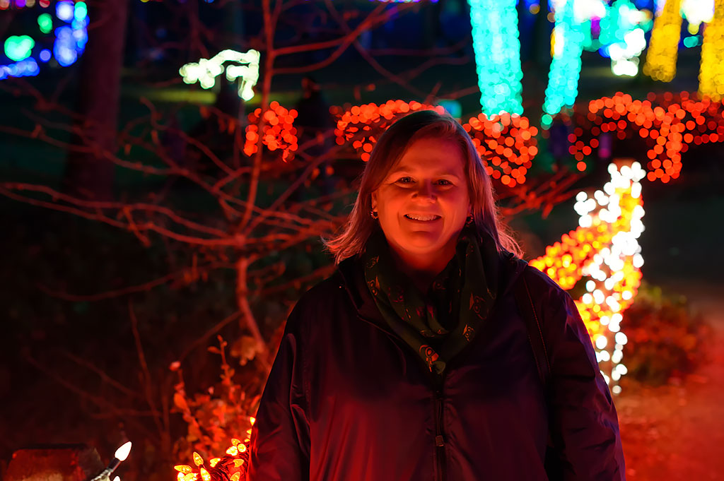 Peg stops for a photo at Winter Walk of Lights