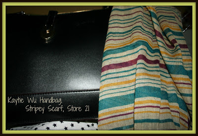 A picture of a Kaytie Wu handbag and stripey scarf from Store 21
