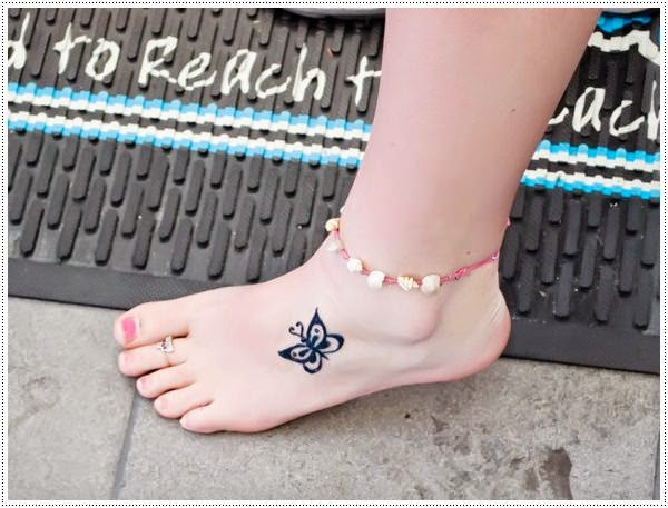 small cute butterfly tattoo on foot for girl
