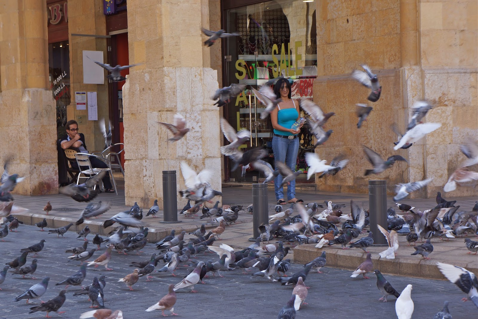 A girl feeding pigeons in Beirut, Lebanon.