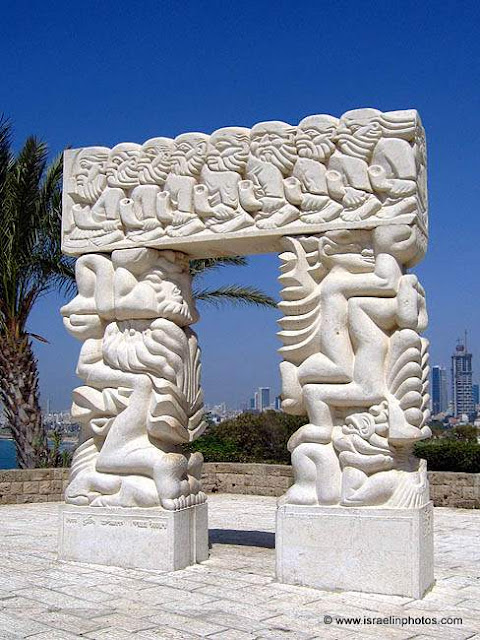 A gate with lessons from the bible carved into the surface