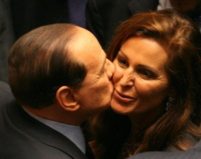 Silvio Berlusconi's Judas kiss