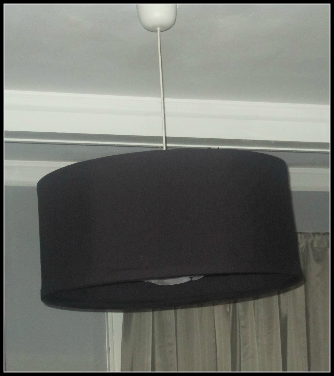 covered it with fabric and hot glued it over the ikea filsta light pendant i already had i didnt glue it to the ikea filsta i glued the wood strips over