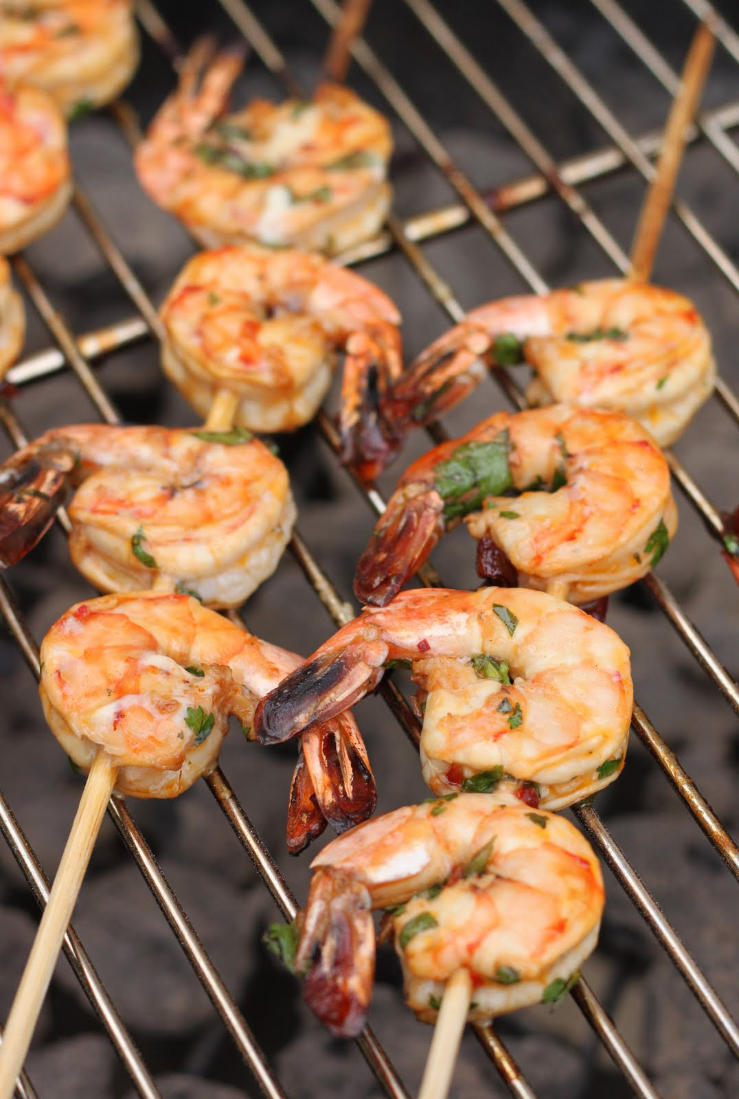 Skewered and marinated shrimp, with an orange hue from the ancho ...