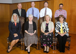 Alumni Relations Coordinator Cutty Gilbert and Operations Manager Ann Broussard (seated, far left, second to left, respectively) have worked in the College for 20 years.