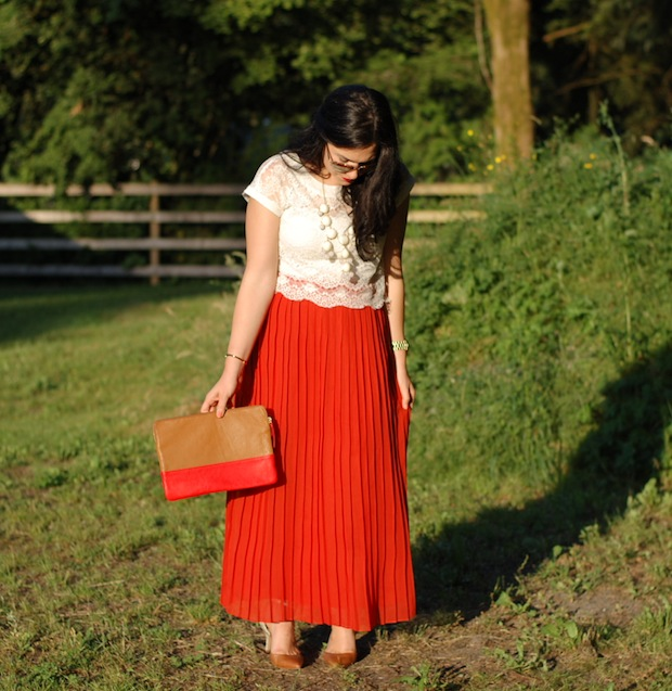Eyelash lace crop top, pleated red maxi skirt, Ily Couture statement necklace, Aldo Heliette heels and a Gap clutch.