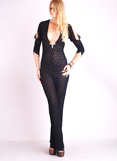 Vintage 1970's black lace jumpsuit with cut-out sleeves and deep plunging neckline.
